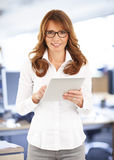 Middle age businesswoman with digital tablet Stock Photography