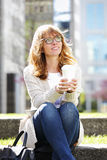 Middle age businesswoman portrait. Portrait of middle age professional woman sitting at office park while drinking coffee and looking up Stock Photos