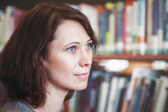 Middle age caucasian woman in library Stock Photos