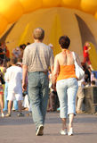 Middle age couple. Walking to street festival Royalty Free Stock Photo