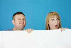 Middle Age Couple Behind White Cover Stock Photos