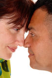Middle age couple with forehead together. Royalty Free Stock Photos