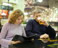 Middle age couple reading menu card Stock Photo