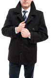 Middle age elegant man posing wearing overcoat. Middle age business man posing wearing elegant overcoat holding collar isolated on white background Royalty Free Stock Photos