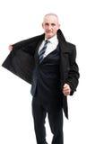 Middle age elegant man posing wearing overcoat Stock Photo