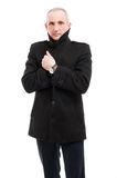 Middle age elegant man posing wearing overcoat. Middle age business man posing wearing elegant overcoat like being cold isolated on white background Royalty Free Stock Images