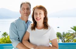 Middle age family couple on vacation resort on sea background. Summer people travel to tropical beach. Summertime leisure. Middle age family couple on vacation royalty free stock images
