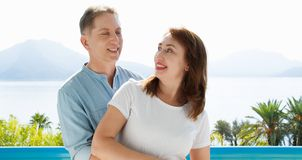 Middle age family couple on vacation resort on sea background. Summer people travel to tropical beach. Summertime leisure. Middle age family couple on vacation royalty free stock photo