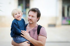 Middle age father with his crying little son outdoors Stock Photos