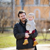 Middle age father with his toddler son outdoors Royalty Free Stock Photos