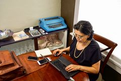 Middle Age Female Telecommuting To Work Royalty Free Stock Images