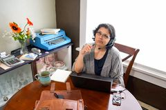 Middle Age Female Telecommuting To Work Stock Photo