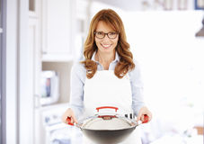 Middle age housewife Stock Images