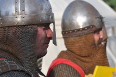 Middle age knights. Portrait of middle Age Knights with iron helmet and chain mail Royalty Free Stock Photos