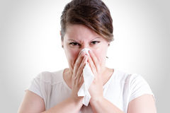 Middle Age Lady Blowing Her Nose too hard Royalty Free Stock Photography