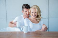 Middle Age Lovers in Coffee Time Looking at Camera Royalty Free Stock Image