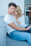 Middle Age Lovers on Couch Looking at Camera Royalty Free Stock Photo