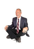 Middle age mal sitting on floor. Royalty Free Stock Photo