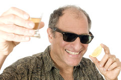 Middle age male drinking tequila sho Stock Photography