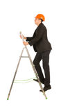 Middle Age Male Engineer on Small Steel Ladder Royalty Free Stock Images