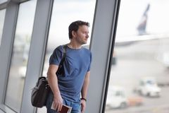 Middle age male passenger at the airport Stock Photography