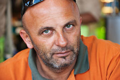 Middle age man. Caucasian man in his forties with orange t-shirt Royalty Free Stock Images