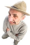 Middle age man adventure hat fish eye view. Middle age senior man fish eye view expressive face scowling angry mad wearing adventure hat Royalty Free Stock Image