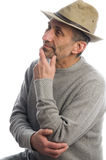 Middle age man adventure hat thinking Stock Image