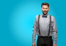 Middle age man wearing a suit. Middle age man, with beard and bow tie with sad and upset expression, unhappy Royalty Free Stock Image