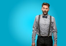 Middle age man wearing a suit. Middle age man, with beard and bow tie with sad and upset expression, unhappy Royalty Free Stock Photo