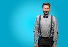 Middle age man wearing a suit. Middle age man, with beard and bow tie with sad and upset expression, unhappy Royalty Free Stock Photos