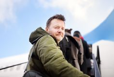Middle age man during boarding on plane at aircraft Stock Images