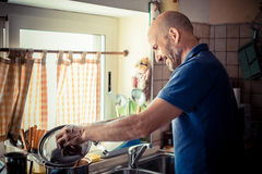 Middle age man cooking Royalty Free Stock Image