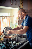 Middle age man cooking Stock Photography