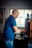Middle age man cooking Stock Images