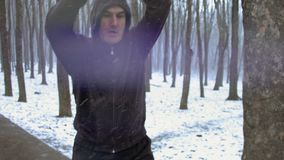 Middle age man doing physical exercices outdoor on a snowy day. Motivational, healthy way of life. Time lapse