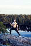 Middle age man doing sport yoga on the top of the mountain, lifestyle people outdoor, summer wild nature for training Royalty Free Stock Images
