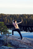 Middle age man doing sport yoga on the top of the mountain, lifestyle people outdoor, summer wild nature for training Stock Photos