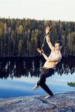 Middle age man doing sport yoga on the top of the mountain, lifestyle people outdoor, summer wild nature for training Royalty Free Stock Photo