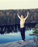 Middle age man doing sport yoga on the top of the mountain, lifestyle people outdoor, summer wild nature for training Stock Photography