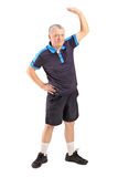 Middle age man exercising. Full length portrait of a middle age man exercising  on white background Stock Images