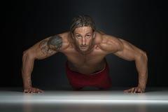 Middle Age Man Exercising In Studio Push Ups Stock Photos