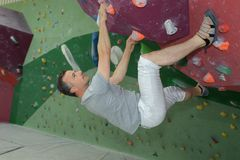 Middle age man on extreme climbing wall royalty free stock photo