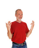 Middle age man with finger crossed. Royalty Free Stock Photo
