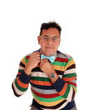 Middle age man fixing his bowtie. Royalty Free Stock Photography