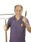 Middle age man gardener  spade and  bow rake tools Royalty Free Stock Images