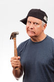 Middle Age Man with a Hammer Royalty Free Stock Photos