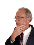 Middle age man with hand on chin. Stock Images
