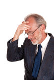 Middle age man with hand on forehead. Royalty Free Stock Photography