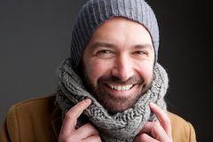 Middle age man with hat and scarf. Portrait of middle age man with hat and scarf royalty free stock images